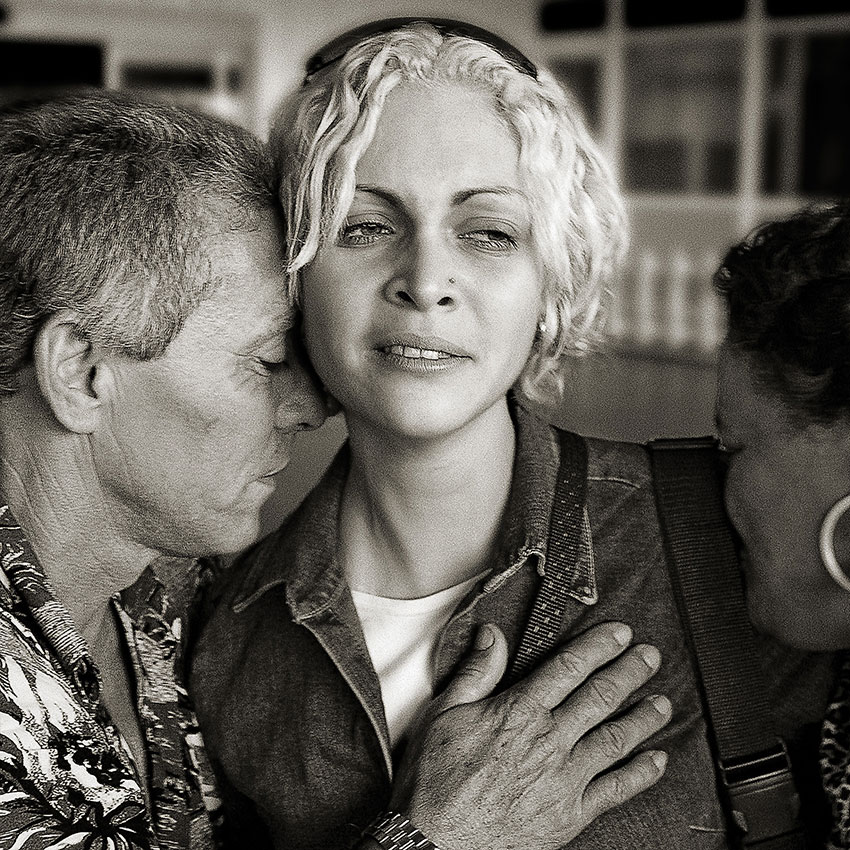 """After one month away from home for the first time, Raysa is greeted at Jose Marti Airport in Havana on her arrival in Cuba by her parents, Pedro and Marisol. Two days later, her father commented about how his daughter is beginning to regain her confidence. """"My daughter is no longer fearful to leave her room and is beginning to go into public again."""""""