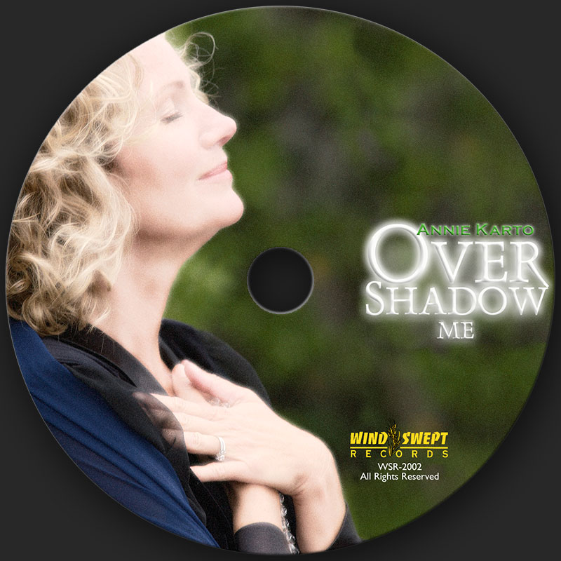Compact Disk design for Overshadow Me by Catholic singer and songwriter, Annie Karto. This work received a Unity Award for Album Packaging of the Year by United Catholic Music & Video Artists (UCMVA), as well as a Unity Award for Album of the Year for Annie Karto.